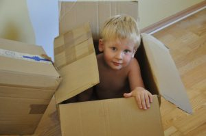 A boy in a moving box.
