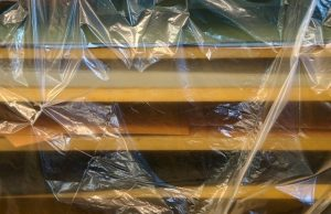 Wooden boards wrapped in plastic wrap.