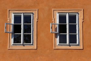 Two windows on orange facade after replacing windows in your home