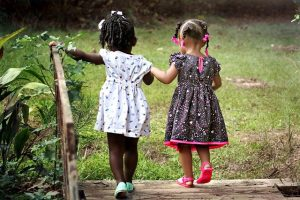 Two girls holding hands.