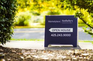 A sign saying Open House