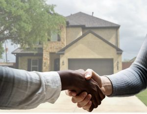 A handshake with a real estate agent.