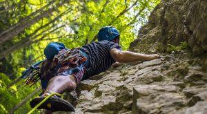 A man climbing rocks.