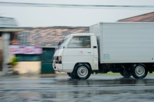 an image of a white moving truck in motion