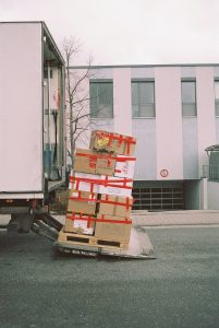 A pile of packed moving boxes.